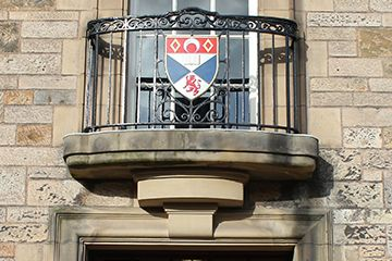 Crest above the door to College Gate