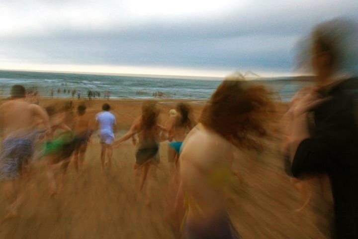 Students running into the North Sea for the May Dip
