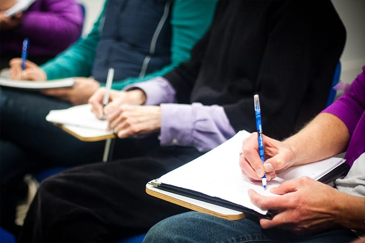 Students taking notes in a lecture