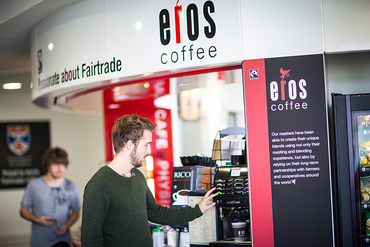 A student using a coffee machine at the Physics cafe