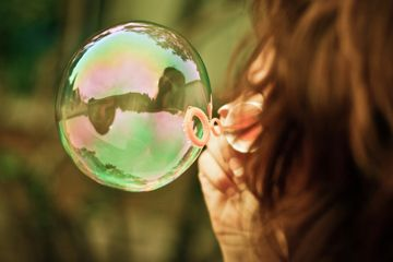Child blowing bubbles - activities for children