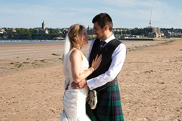 Weddings in St Andrews - couple on the beach