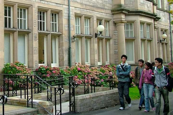 Students walk by one of the University buildings