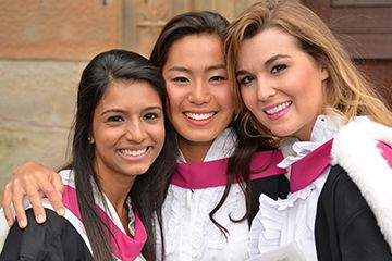 Female St Andrews graduates posing for a photograph together