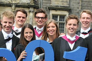 Young University of St Andrews students posing for a photo together