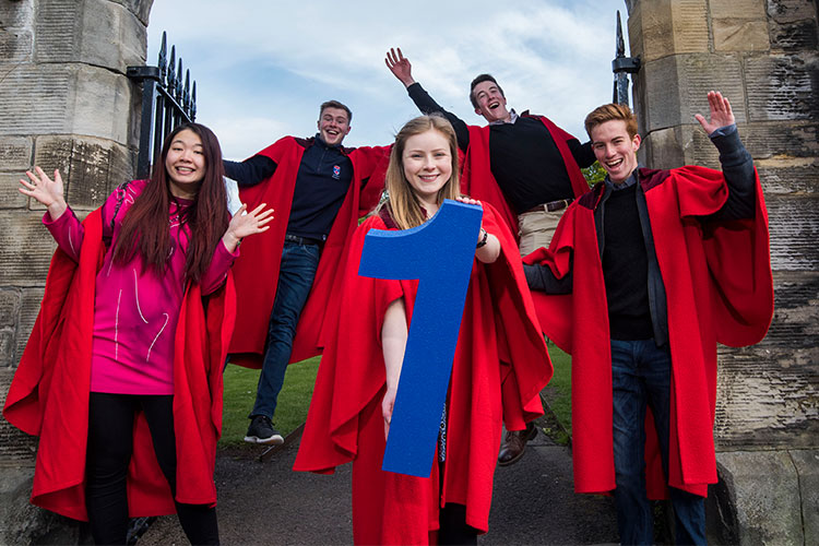 St Andrews students in red gowns celebrating