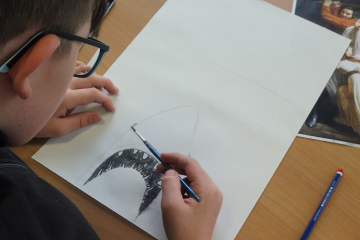 A secondary school pupil creates a pen and ink drawing of the shark from Jaws.