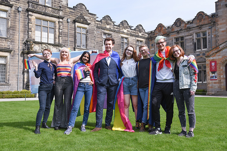 Students with a rainbow flag