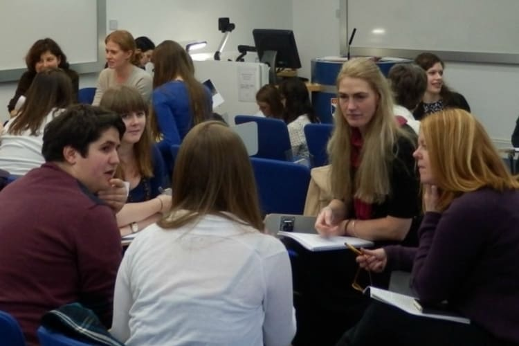 Students discussing work