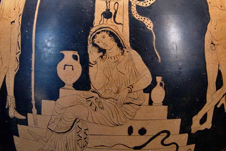 Woman sitting on steps with amphora beside her