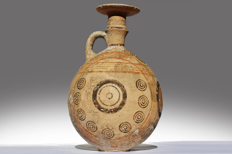 ancient jug with round body, tiny hand and narrow neck