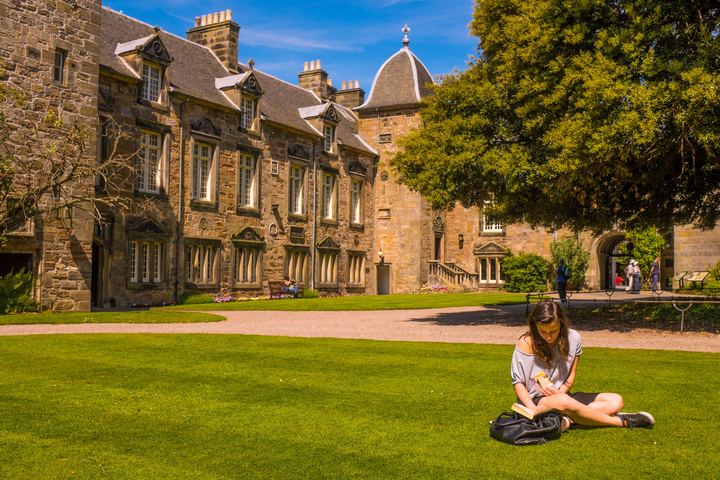 Girl reading in St Mary's Quad