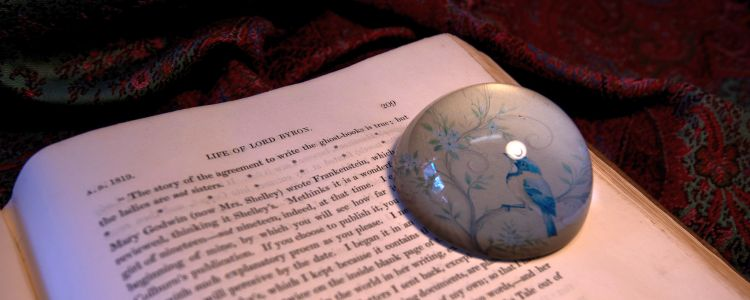 Open book with paperweight