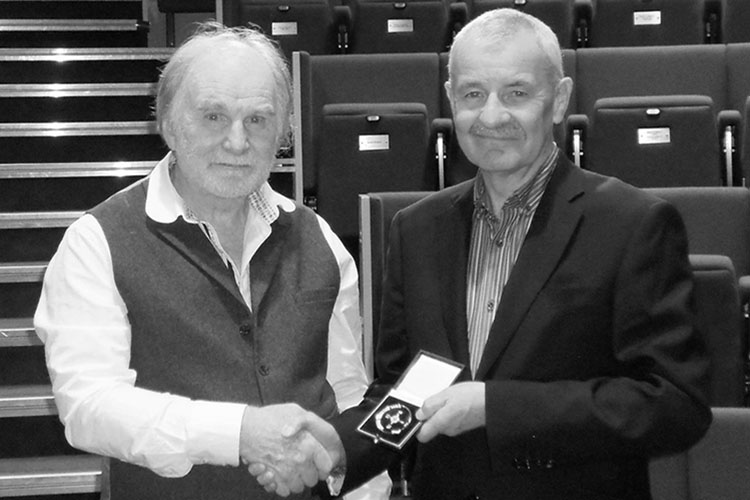 Doug Benn receiving the Coppock Medal from John Briggs