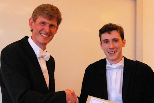 Adam receiving the projectprize certificate from Head of School.