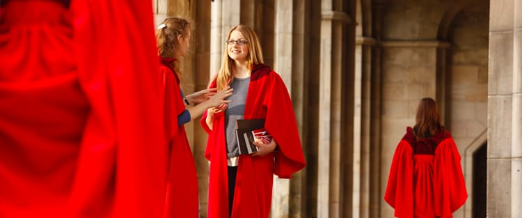 Students wearing their red gowns