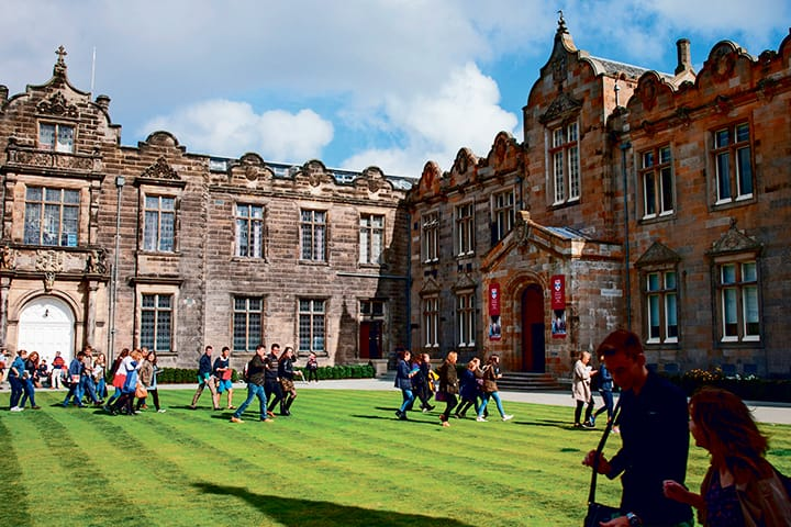 Students walking through St Salvator's Quadrangle