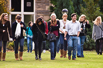 Students walking on the lawn in St Mary's Quad