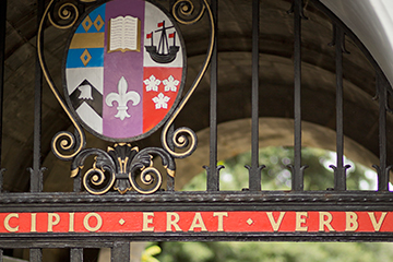 The University crest on the gate to St Mary's Quad