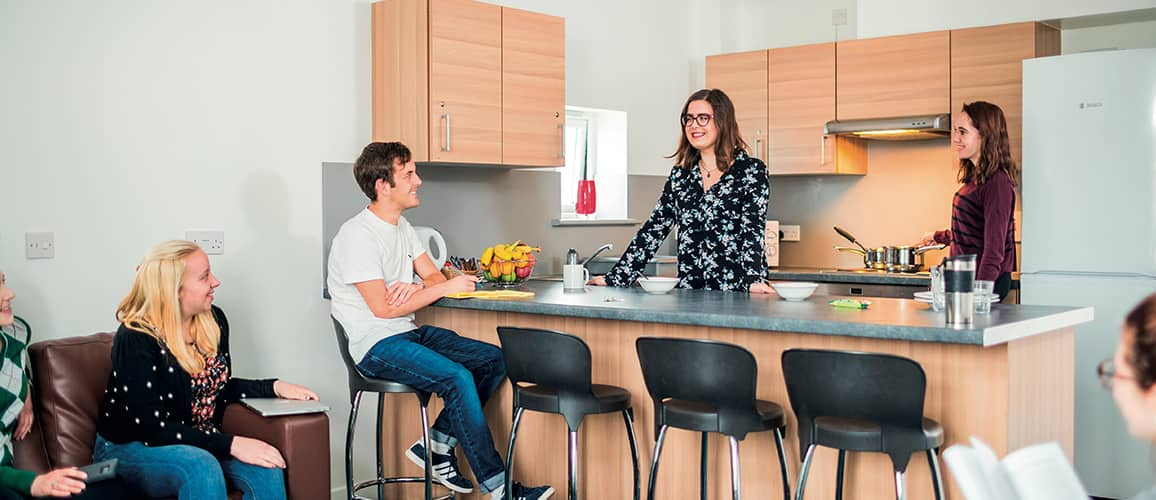 People chatting in a kitchen