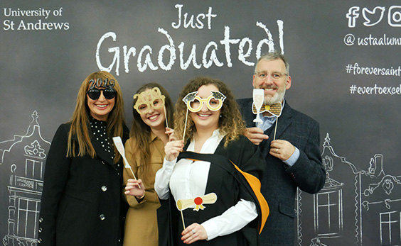 new graduate and family