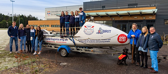 group photo with boat