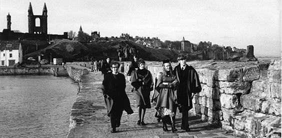 black and white image of students on pier