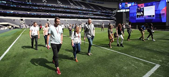 attendees on football pitch