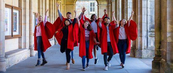 group of students in red gowns