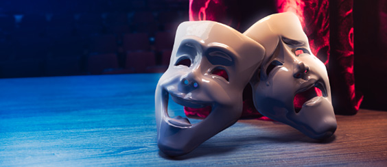 two masks on stage