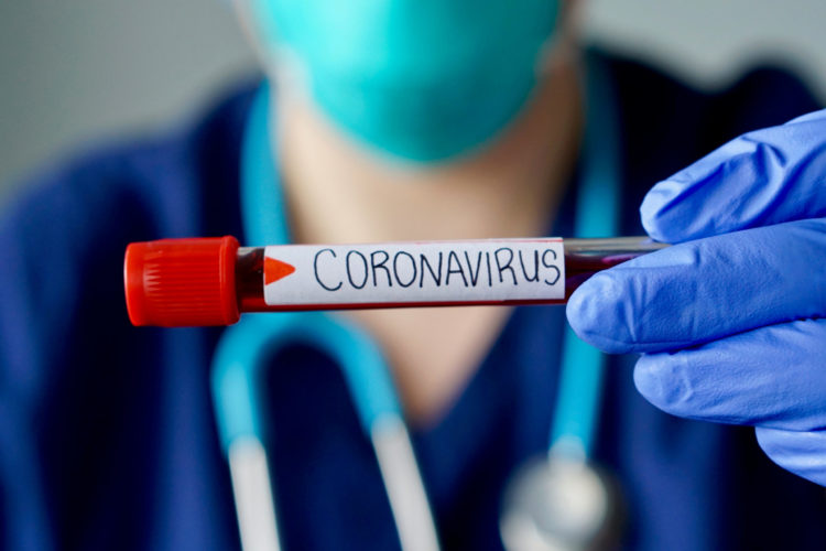 Coronavirus written on a test tube