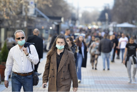 people with facemasks on in street