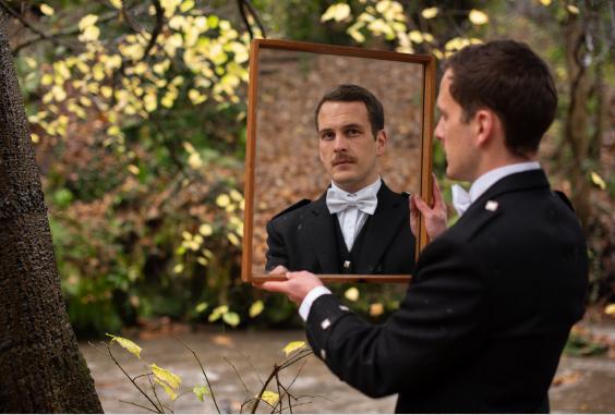 Man holding a mirror