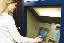 Female student using ATM
