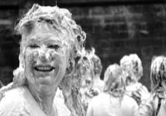 student enjoying foam fight on raisin